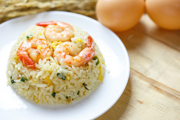 fried rice with shrimp on wood table