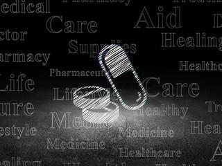 Health concept: Pills in grunge dark room
