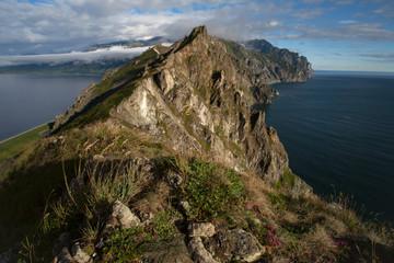 The narrow rocky ridge and the sea on both sides. Peninsula Kony. The Sea of Okhotsk. Magadan Region. Russia.