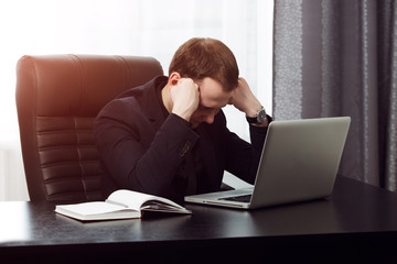 Businessman is tired and can not work anymore