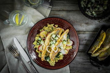 Grilled catfish with quinoa and radish salad