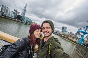 Loving couple taking a selfie in London