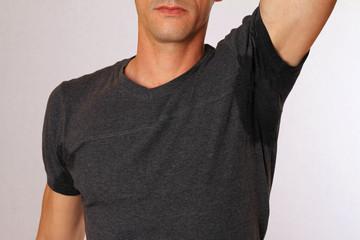 Sport man armpit sweating. Transpiration stain. Hyperthyroidism concept