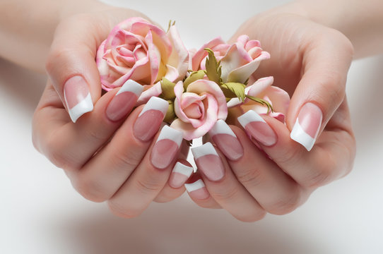delicate French manicure with a rose in hand