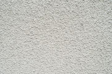 Gray wall closeup uneven granular cement coating
