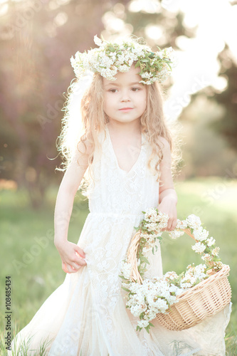 2806db6c0ff5 Cute baby girl 3-4 year old wearing trendy white dress and floral ...