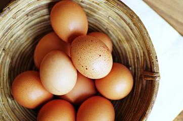 Eggs. Eggs in basket.  Fresh organic raw eggs in wooden basket.
