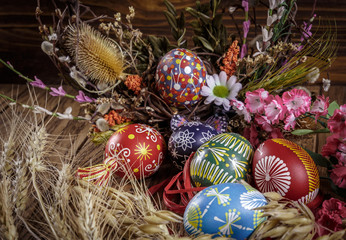 Easter decoration. colored Easter eggs and composition of dry flowers and ears