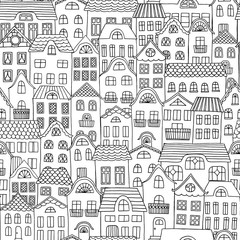 Hand drawn seamless pattern of a city with cute little houses