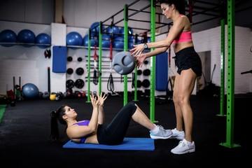 Women exercising with a medicine ball