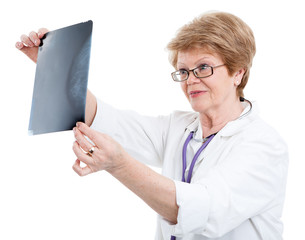 An elder Caucasian female doctor looking an X-ray image, isolated on white background