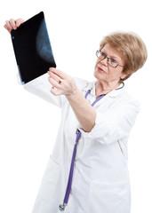 Elderly doctor radiologist examines x-ray image, isolated on white background
