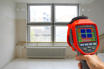 Recording Radiator and a window on a building with Thermal Camer