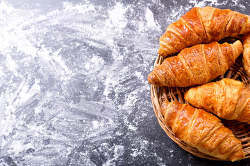 fresh croissants on dark background