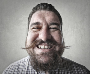 Smiling man with mustache