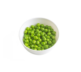 green peas in a white bowl isolated