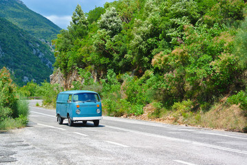 Oldtimer bus on mountain road