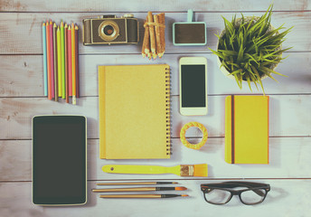 top view photo of blank notebook, old camera and school supplies
