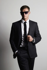 handsome Man in suit.young businessman in sunglasses