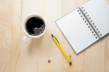 Coffee cup with notebook