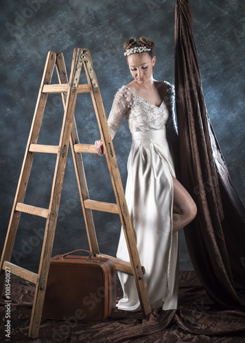 Full Length Vertical Artistic Studio Image Of A Model Wearing White Wedding Dress And Standing