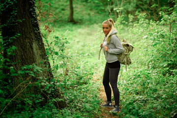 Young hiker woman with backpack