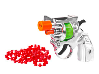 Mini toy gun with powder isolated on white background