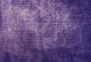 Worn magenta denim texture.
