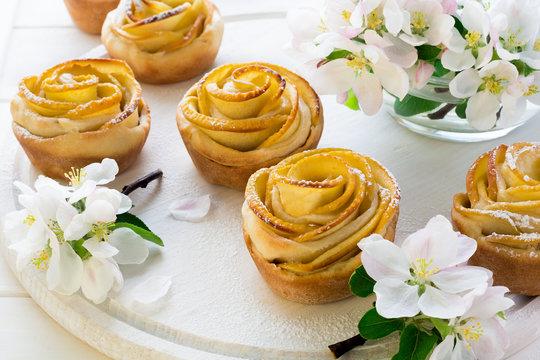 Homemade apple rose cakes decorated apple blossom on white wooden desk