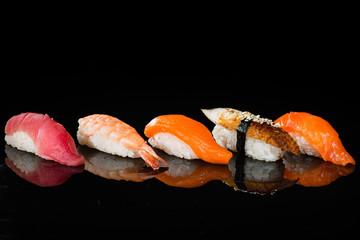 assortment of nigiri sushi with shrimp, salmon, tuna and eel