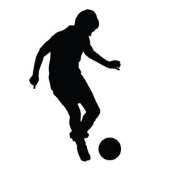 Young soccer player passes the ball silhouette, kid plays soccer