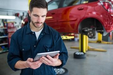 Mechanic using digital tablet