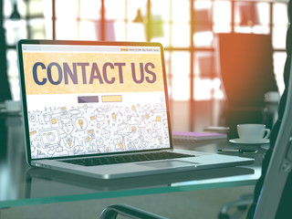 Contact Us Concept. Closeup Landing Page on Laptop Screen in Doodle Design Style. On Background of Comfortable Working Place in Modern Office. Blurred, Toned Image. 3D Render.
