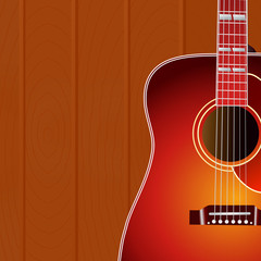 Acoustic guitar against the wood wall background with copy space for your text . Music cover.