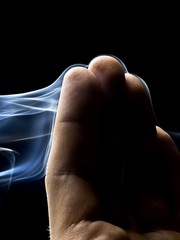 fingers in abstract smoke