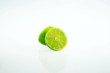 Fresh limes on white background