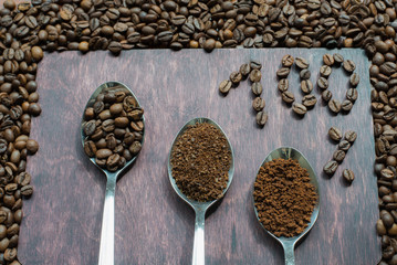 Three stages of spoons in coffee - beans, ground, instant