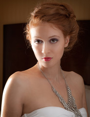 Gorgeous Redhead in Strapless Top and Necklace