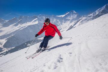 Young happy man skiing in Lenzerheide ski resort, Switzerland.