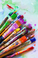 Artist paintbrushes closeup on canvas.