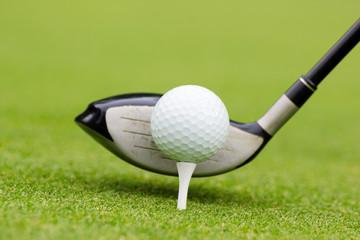 golf club behind the ball