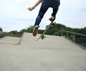 young woman skateboarder skateboarding at skate park
