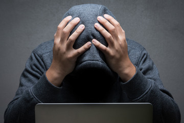 disappointed hacker with computer notebook