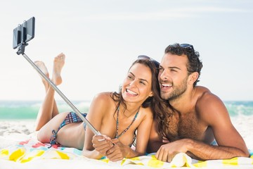 Couple taking selfie at the beach
