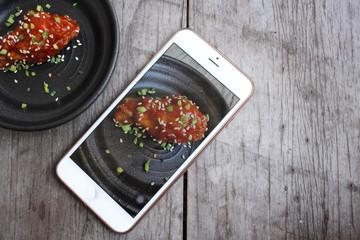 Take photo of korean fried chicken with smart phone