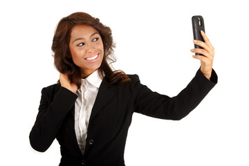 Business woman using a cellphone taking a selfie