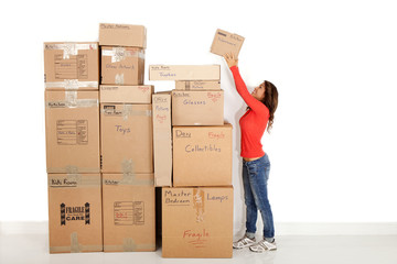 Woman packing and getting ready to move