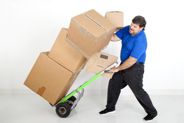 Man moving boxes with a hand cart or dollie and dropping them