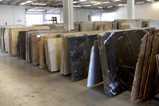 Slabs of granite in a storage warehouse.