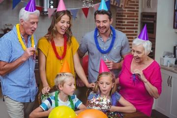 Happy multi generation family celebrating birthday